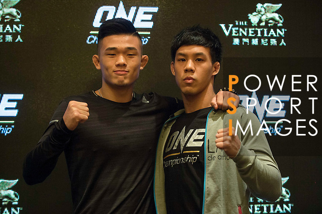 Christian lee (l) and Eddie Ng (r) fighters of One Championship - Heroes of the World pose for photos during the press conference on 04 August 2016 held at Conrad Hotel, Hong Kong, China. Photo by Marcio Machado / Power Sport Images