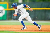 Mark Threlkeld (26) of the Burlington Royals takes off for second base against the Danville Braves at Burlington Athletic Park on July 19, 2012 in Burlington, North Carolina.  The Royals defeated the Braves 4-3.  (Brian Westerholt/Four Seam Images)