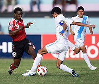 Gerardo Gordillo (2) of Guatemala tries to take the ball away from Shackiel Henry (9) of Trinidad & Tobago  during the group stage of the CONCACAF Men's Under 17 Championship at Jarrett Park in Montego Bay, Jamaica. Trinidad & Tobago defeated Guatemala, 1-0.