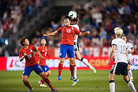 Korea Republic (KOR) midfielder Kim Narae (15) goes up for a header with United States (USA) midfielder Yael Averbuch (16). The women's national team of the United States defeated the Korea Republic 5-0 during an international friendly at Red Bull Arena in Harrison, NJ, on June 20, 2013.