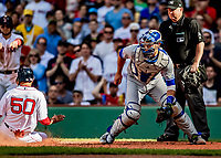 Jun 22, 2019; Boston, MA, USA; Toronto Blue Jays catcher Luke Maile awaits a late throw home as Boston Red Sox right fielder Mookie Betts slides home safely in the second inning at Fenway Park. Mandatory Credit: Ed Wolfstein-USA TODAY Sports