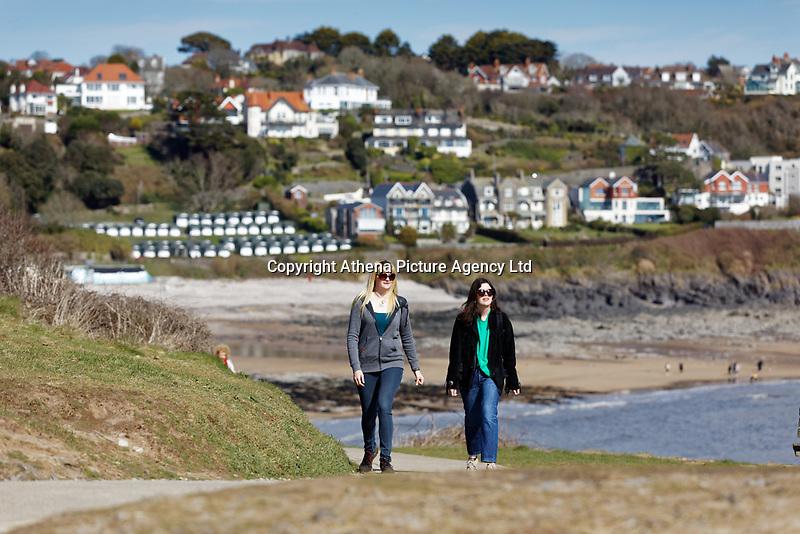 Pictured: Two women walk on the coastal path by Langland Bay near Swansea, Wales, UK. Sunday 22 March 2020<br /> Re: Covid-19 Coronavirus pandemic, UK.