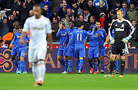 Saturday, 03 November 2012<br /> Pictured: Victor Moses of Chelsea (in blue 2nd R) celebrating the opening goal with team mates while Swansea players Wayne Routledge (L) and goalkeeper Gerhard Tremmel (R) look dejected.<br /> Re: Barclays Premier League, Swansea City FC v Chelsea at the Liberty Stadium, south Wales.