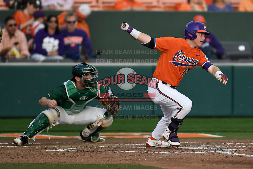 Designated hitter Robert Jolly (12) of the Clemson Tigers bats in a game against the William and Mary Tribe on February 16, 2018, at Doug Kingsmore Stadium in Clemson, South Carolina. The catcher is Hunter Smith. Clemson won, 5-4 in 10 innings. (Tom Priddy/Four Seam Images)