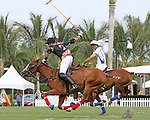 """WELLINGTON, FL - APRIL 25:  Juan """"Jota"""" Chavanne takes a shot at the goal as Valiente's Adolfo Cambiaso (white jersey) looks on, as Valiente defeats Orchard Hill 13-12, in OT,  in the US Open Polo Championship Final, to win the U. S. Polo Triple Crown, at the International Polo Club Palm Beach, on April 25, 2017 in Wellington, Florida. (Photo by Liz Lamont/Eclipse Sportswire/Getty Images)"""