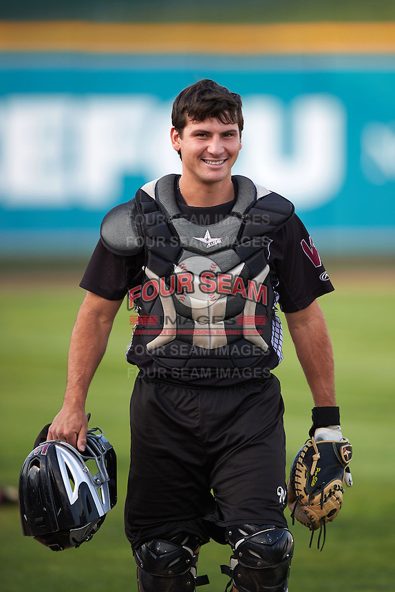 Wisconsin Timber Rattlers catcher Carlos Leal (11) during practice before a game against the Peoria Chiefs on August 21, 2015 at Dozer Park in Peoria, Illinois.  Wisconsin defeated Peoria 2-1.  (Mike Janes/Four Seam Images)