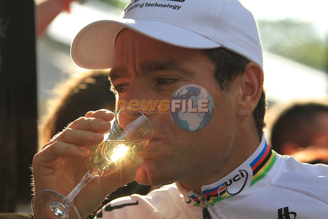 World Champion Cadel Evans (AUS) BMC Racing Team enjoys a glass of champagne part of the team parade at the end of the final Stage 20 of the 2010 Tour de France running 102.5km from Longjumeau to Paris Champs-Elysees, France. 25th July 2010.<br /> (Photo by Eoin Clarke/NEWSFILE).<br /> All photos usage must carry mandatory copyright credit (© NEWSFILE | Eoin Clarke)