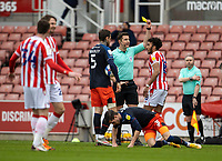 20th February 2021; Bet365 Stadium, Stoke, Staffordshire, England; English Football League Championship Football, Stoke City versus Luton Town; Jacob Brown of Stoke City receives a yellow card for a tackle on Dan Potts of Luton Town