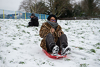 A mum having fun sledging in the park following Heavy Snowfall at Sidcup, Kent, England on the 8 February 2021. Photo by Alan Stanford.
