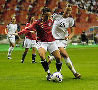Norway's Gunhild Folstad (3) shields the ball from U.S. forward Abby Wambach (20). The United States (USA) defeated Norway (NOR) 4-1 during the third place match of the Women's World Cup China 2007 at Shanghai Hongkou Football Stadium in Shanghai, China, on September 30, 2007.