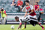 Juventus' player Roberto Pereyra contests the ball against South China's player Sean Tse Ka Keung during the South China vs Juventus match of the AET International Challenge Cup on 30 July 2016 at Hong Kong Stadium, in Hong Kong, China.  Photo by Marcio Machado / Power Sport Images