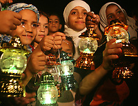 """Palestinian children carrying  amadan traditional lamps  they celebrate in  Ramadan, a holy month of dawn-to-dusk fasting, festivities and abstinence, at the center of Gaza City, 17 September 2007. """"photo by Fady Adwan"""""""