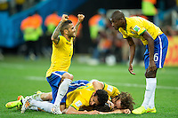 Oscar of Brazil celebrates scoring a goal with team mates after making it 3-1