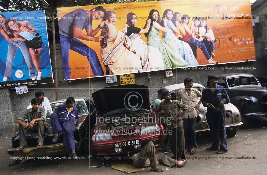 INDIA Mumbai Bombay , cinema poster for Bollywood movies and car garage, copyright (c) Joerg Boethling