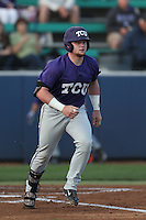 Evan Skoug (9) of the TCU Horned Frogs runs to first base during a game against the Loyola Marymount Lions at Page Stadium on March 16, 2015 in Los Angeles, California. TCU defeated Loyola, 6-2. (Larry Goren/Four Seam Images)