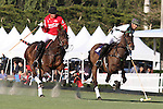 WELLINGTON, FL - JANUARY 08:  #2 Nic Roldan of the Grand Champions Polo Club, looks to pass the ball, while being pursued by Del Walton of Coca Cola, during the early rounds of the Joe Barry Memorial Cup, at the International Polo Club, Palm Beach on January 03, 2017 in Wellington, Florida. (Photo by Liz Lamont/Eclipse Sportswire/Getty Images)