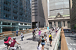 NEW YORK - AUGUST 11:  Bicyclist, joggers and walkers enjoy Car Free Streets on Park Ave as part of New York City's Summer Streets August 11, 2012 in New York City. (Photo by Donald Bowers)