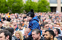 Supporters - Luton Town players and staff celebrate promotion in front of supporters during an open top bus journey through the streets of Luton displaying the trophy afte gaining promotion to the EFL Championship from League One on 5 May 2019. Photo by David Horn.