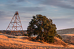 Landscape with the Fremont Mine headframe beneath passing storm front, late spring, Amador County, Calif.