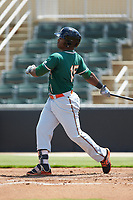 Isael Soto (15) of the Greensboro Grasshoppers follows through on his swing against the Kannapolis Intimidators at Kannapolis Intimidators Stadium on August 5, 2018 in Kannapolis, North Carolina. The Grasshoppers defeated the Intimidators 2-1 in game one of a double-header.  (Brian Westerholt/Four Seam Images)