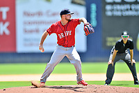 Greenville Drive starting pitcher Chase Shugart (12) attempts a pickoff during a game against the Asheville Tourists on July 18, 2021 at McCormick Field in Asheville, NC. (Tony Farlow/Four Seam Images)