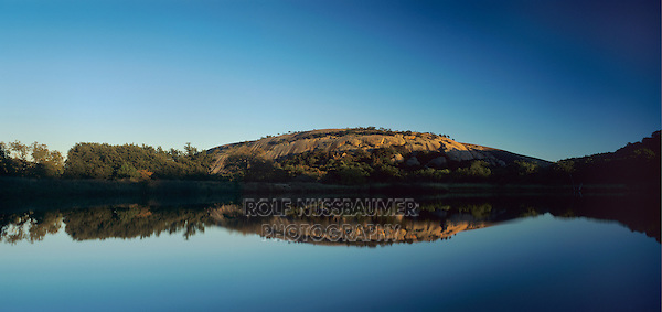 Dome reflecting in pond at sunset, Enchanted Rock State Natural Area, Fredericksburg,Texas, USA
