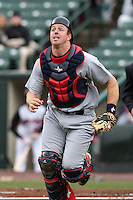 Lehigh Valley IronPigs catcher Erik Kratz #19 chases down a pop up during a game against the Rochester Red Wings at Frontier Field on April 22, 2012 in Rochester, New York.  Rochester defeated Lehigh Valley 3-2.  (Mike Janes/Four Seam Images)