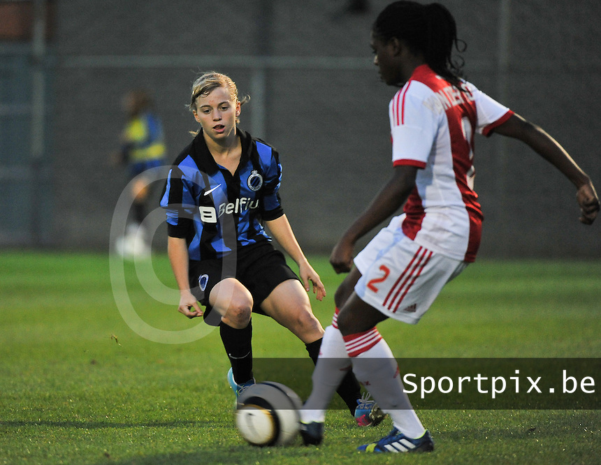 20130830 - VARSENARE , BELGIUM : Brugge's Yana Haesebroek (left) pictured during the female soccer match between Club Brugge Vrouwen and Ajax Amsterdam Dames , of the first matchday in the BENELEAGUE competition. Friday 30 August 2013. PHOTO DAVID CATRY