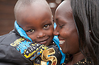 2011 London Marathon winner Mary Keitany with her child Jared  at their home in Iten, Kenya.