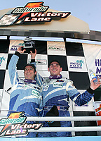 Marc Bunting and Andy Lally celebrate their GT class win at the Grand Prix od Miami at Homestead-Miami Speedway on Saturday, March 5, 2005.(Grand American Road Racing Photo by Brian Cleary)