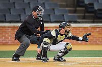Wake Forest Demon Deacons catcher Ben Breazeale (9) sets a target as home plate umpire David Pritchett looks over his shoulder during the NCAA baseball game against the Georgetown Hoyas at Wake Forest Baseball Park on February 16, 2014 in Winston-Salem, North Carolina.  The Demon Deacons defeated the Hoyas 3-2.  (Brian Westerholt/Four Seam Images)