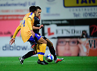Lincoln City's Ramirez Howarth vies for possession with Mansfield Town's James Perch<br /> <br /> Photographer Andrew Vaughan/CameraSport<br /> <br /> EFL Trophy Northern Section Group E - Mansfield Town v Lincoln City - Tuesday 6th October 2020 - Field Mill - Mansfield  <br />  <br /> World Copyright © 2020 CameraSport. All rights reserved. 43 Linden Ave. Countesthorpe. Leicester. England. LE8 5PG - Tel: +44 (0) 116 277 4147 - admin@camerasport.com - www.camerasport.com
