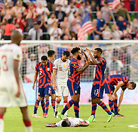 AUSTIN, TX - JULY 29: Eryk Williamson #19 and Kellyn Acosta #23 of the United States celebrates their win after a game between Qatar and USMNT at Q2 Stadium on July 29, 2021 in Austin, Texas.