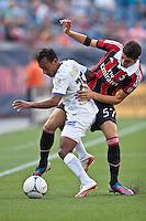AC Milan midfielder Mattia Valoti (57) tackles Olimpia midfielder Javier Portillo (25).  AC Milan defeated Olimpia 3-1 at Gillette Stadium on August 4, 2012
