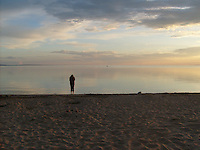 Contemplating the tranquility of a glassy calm Slave Lake, Alberta.