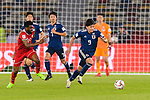 Minamino Takumi of Japan (R) in action during the AFC Asian Cup UAE 2019 Group F match between Oman (OMA) and Japan (JPN) at Zayed Sports City Stadium on 13 January 2019 in Abu Dhabi, United Arab Emirates. Photo by Marcio Rodrigo Machado / Power Sport Images
