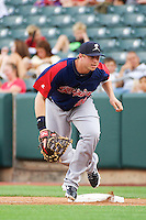 Justin Smoak (22) of the Tacoma Rainiers on defense against the Salt Lake Bees in Pacific Coast League action at Smith's Ballpark on July 9, 2014 in Salt Lake City, Utah.  (Stephen Smith/Four Seam Images)
