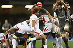 Tonga scrum half Taniela Moa clears the ball from the back of the breakdown<br /> <br /> Dove Men Series 2013<br /> Wales v Tonga<br /> Millennium Stadium - Cardiff<br /> 22.11.13<br /> ©Steve Pope-SPORTINGWALES