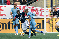 FOXBOROUGH, MA - SEPTEMBER 29: Luis Caicedo #27 of New England Revolution comes in to tackle Maximiliano Moralez #10 of New York City FC during a game between New York City FC and New England Revolution at Gillettes Stadium on September 29, 2019 in Foxborough, Massachusetts.