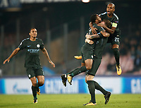 Football Soccer: UEFA Champions League Napoli vs Mabchester City San Paolo stadium Naples, Italy, November 1, 2017. <br /> Manchester City's John Stones (c) celebrates with his teammate Raheem Sterling (l) and captain Fernandinho (r) after scoring during the Uefa Champions League football soccer match between Napoli and Manchester City at San Paolo stadium, November 1, 2017.<br /> UPDATE IMAGES PRESS/Isabella Bonotto