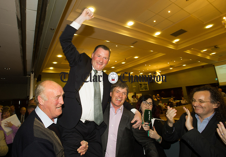Pat Hayes of Fianna Fail is lifted by supporters after he was deemed elected to the delight of his brother and well known musician Martin, at right, during the election count at The West county Hotel, Ennis. Photograph by John Kelly.