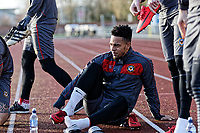 Pictured:  Jazzi Barnum-Bobb wears his boots pitch side before the start of their training session. Thursday 18 January 2018<br /> Re: Players and staff of Newport County Football Club prepare at Newport Stadium, for their FA Cup game against Tottenham Hotspur in Wales, UK