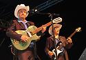 """voz-FoodCityFiestas0919 091407 Two members from the group """"Los Originales Cadetes de Linares"""" (cq) performing at the Food City Fiestas Patrias in Phoenix, on Friday, Sept. 14, 2007.  Photo by AJ Alexander/La Voz"""