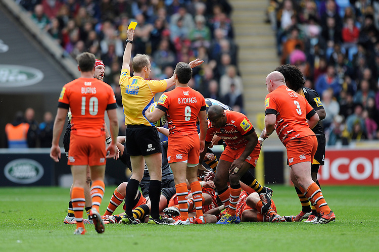 Referee Wayne Barnes initially awards a yellow card to Seremaia Bai of Leicester Tigers but later changes it to a red card