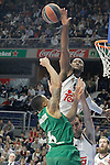 Real Madrid's Andres Nocioni (r) and Marcus Slaughter (t) and Panathinaikos Athens' A.J. Slaughter during Euroleague match.January 22,2015. (ALTERPHOTOS/Acero)