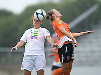 Michelle Moll (23) of the Charlotte Lady Eagles goes up for a header with Molly Bruh (19) of the Long Island Rough Riders during the game at the Maryland SoccerPlex in Boyds, Maryland.  The Charlotte Lady eagles defeated the Long Island Rough Riders, 4-0, to advance to the W-League Eastern Conference Championship.
