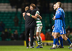 Celtic v St Johnstone....26.12.10  .Ki Sung Yeung is hugged by Neil Lennon at full time.Picture by Graeme Hart..Copyright Perthshire Picture Agency.Tel: 01738 623350  Mobile: 07990 594431