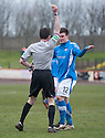 Montrose's Scott Johnston protests his innocence as he is booked by referee Colin Steven after a collision with Berwick keeper Marc McCallum.