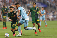 ST PAUL, MN - JULY 24: Juan Agudelo #21 of Minnesota United FC and Pablo Bonilla #28 of the Portland Timbers battle for the ball during a game between Portland Timbers and Minnesota United FC at Allianz Field on July 24, 2021 in St Paul, Minnesota.