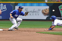 Anthony Seratelli #2 of the Las Vegas 51s takes a throw at second base ahead of a sliding Storm Chaser  against the Omaha Storm Chasers at Werner Park on August 17, 2014 in Omaha, Nebraska. The Storm Chasers  won 4-0.   (Dennis Hubbard/Four Seam Images)